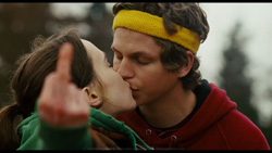 Juno (Ellen Page) kisses Bleeker (Michael Cera) as she gives Leah the finger