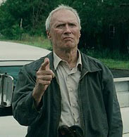 Gran Torino Walt (Clint Eastwood) points his finger gun at local hoods harassing his Korean neighbours
